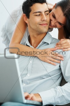 Portrait of happy young couple with laptop
