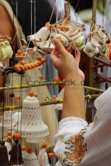 The girl chooses ceramic trinkets,