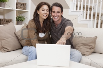 Happy Middle Aged Man & Woman Couple Using Laptop Computer