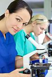 Female Scientist or Woman Researcher Using Microscope in Laborat
