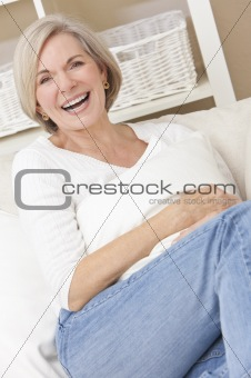 Attractive Happy Senior Woman Laughing at Home