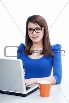 Cute young woman using laptop