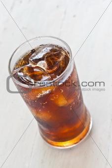 Water, Fresh coke in glass, on white wood