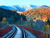 Railway on bridge and first autumn snow 