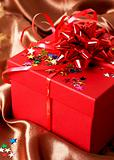Red gift box with bows and stars