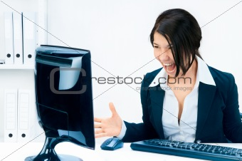 Business woman yelling at the monitor.