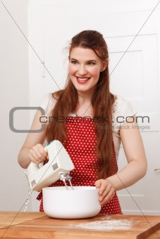 Woman with a hand mixer