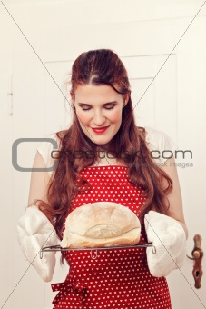 Woman holding a bread