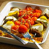 venison skewers with grilled tomatoes and potatoes