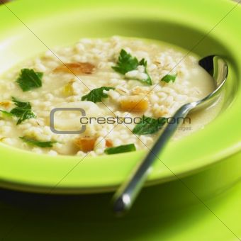 pot barley soup with pork meat pieces