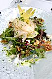 Fresh mixed green salad with pears, walnuts and goat cheese