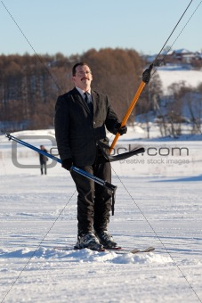 Business man on ski lift