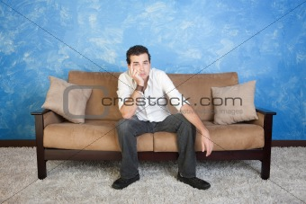 Bored Man on Sofa