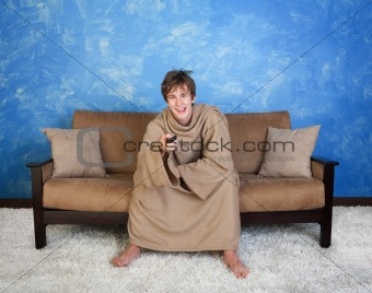 Teen In Bathrobe Watches Television