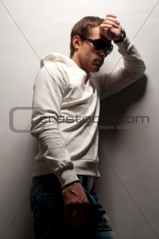 man with athletic standing near a wall
