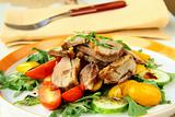 salad with duck breast, cherry tomatoes and arugula