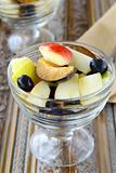 Glass bowl of fresh sweet fruit salad