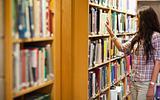 Young woman choosing a book