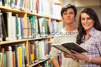 Young students holding a book