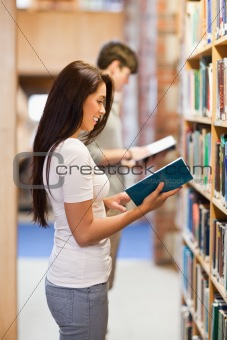 Portrait of students reading while standing up
