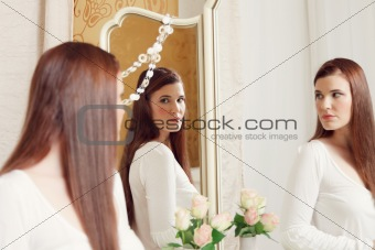 Woman looking into mirror