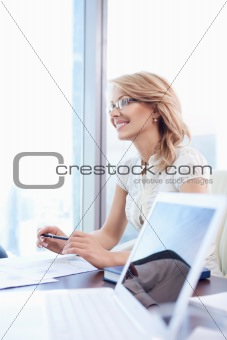 An attractive mature woman in the office