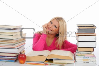young pretty smart woman with lots of books reading and study.