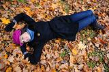 Pretty autumn girl relaxing outdoors in the forest