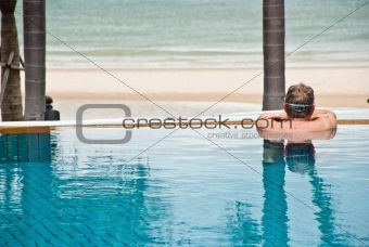 Man in swimming pool relaxing