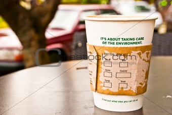 a cup of hot coffee in paper cup for the environment