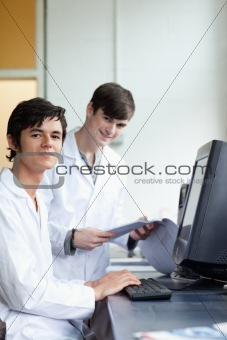 Portrait of male scientists with a monitor