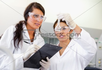 Scientist looking at a Erlenmeyer flask