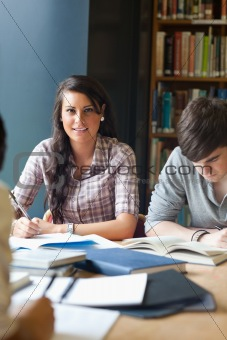 Portrait of young adults studying