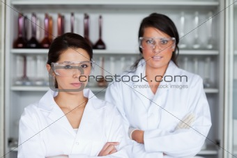 Serious female scientists posing