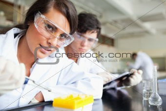 Two scientists making an experiment