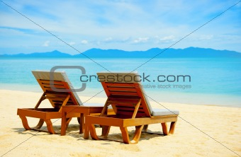 Chairs on the beach near with sea
