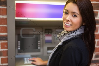Woman withdrawing cash