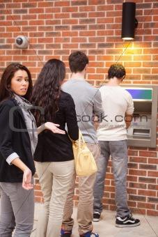 Portrait of an impatient woman queuing