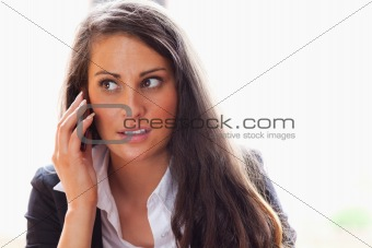 Surprised woman making a phone call