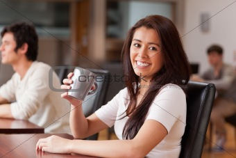 Cute woman having a coffee