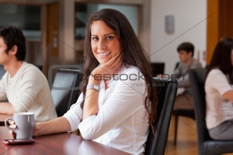 Smiling woman having a coffee