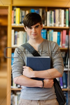 Portrait of young student holding a book