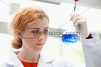 Science student looking at a mixed liquid