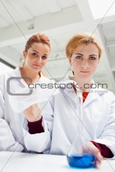 Portrait of cute science students doing an experiment