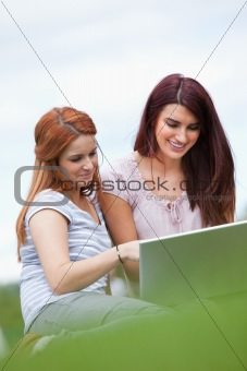 Portrait of women using a notebook