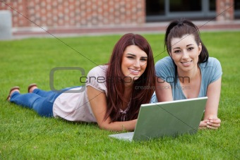 Friends using a notebook