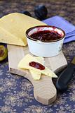 jar of plum jam and some slice cheese