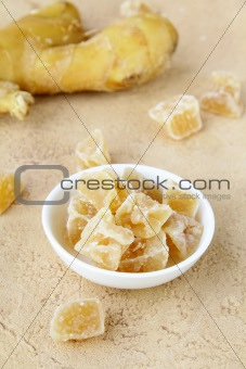 candied ginger and fresh ginger on a beige background