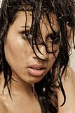 Dark hair beauty in shower face shot