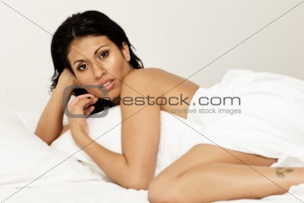 Naked sensual woman in bed